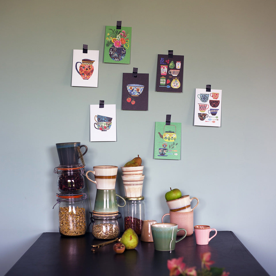 display of Brie harrison postcards stuck to a wall