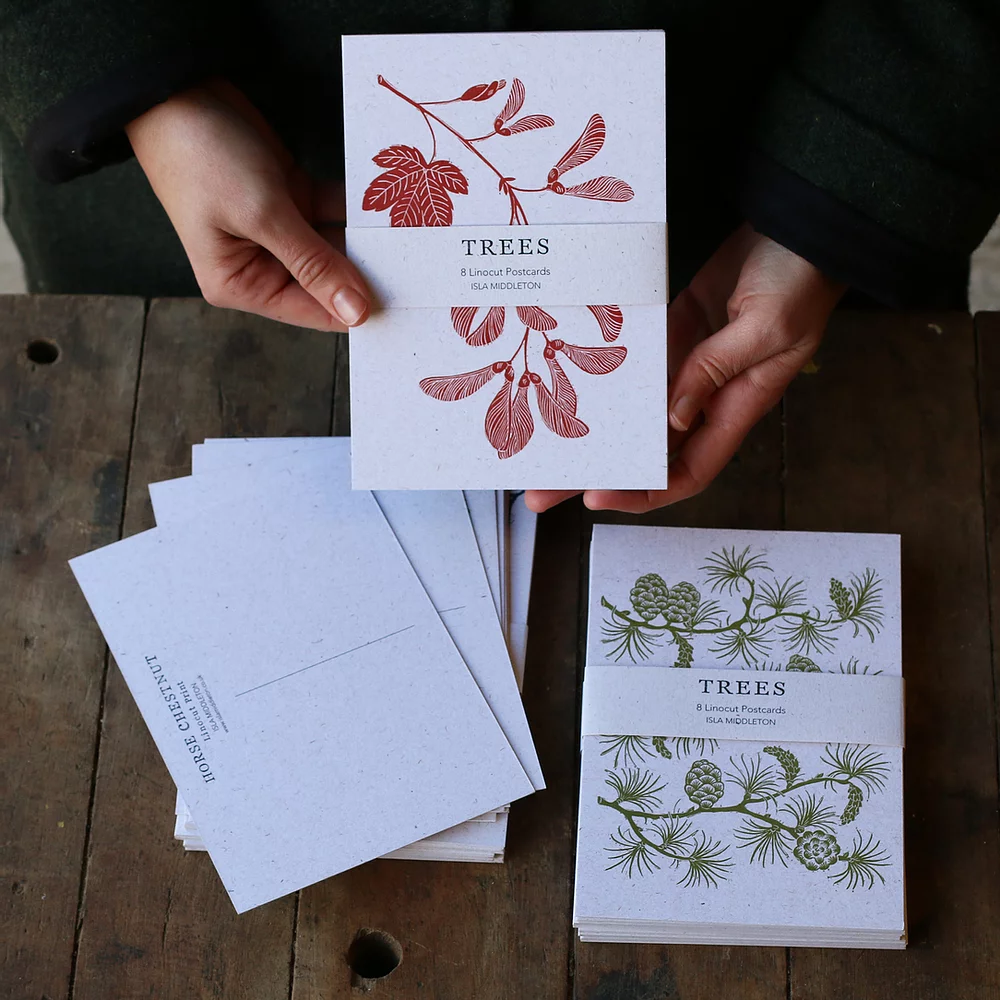 postcards with tree leaves printed on them