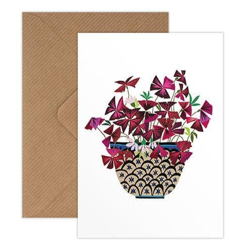 greetings card designed by brie harrison detailing an purple oxalis plant coming out of a vase.