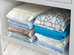 Doona covers folded with pillow cases