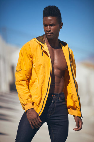 Male model in a yellow jacket outdoors
