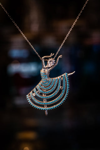 Sterling silver dancer necklace with diamond cut turquoise & CZ stones