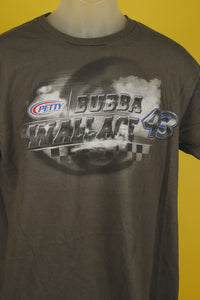 Close up of grey t shirt with Bubba Wallace in capital letters next to the number 43. The design is mostly black and white. There is some blue in the number 43. There is a small logo next to the word bubba that says Petty in red white and blue.