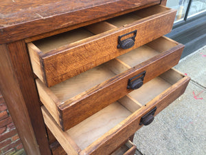 Antique cabinet with 11 drawers and pull-out shelf