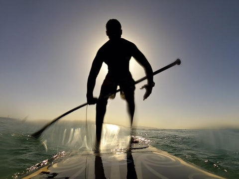 Man paddle boards