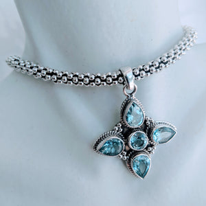 Blue Topaz and Sterling silver 4 point pendant