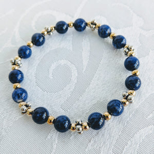 Blue sodalite bracelet with gold/silver caviar accents