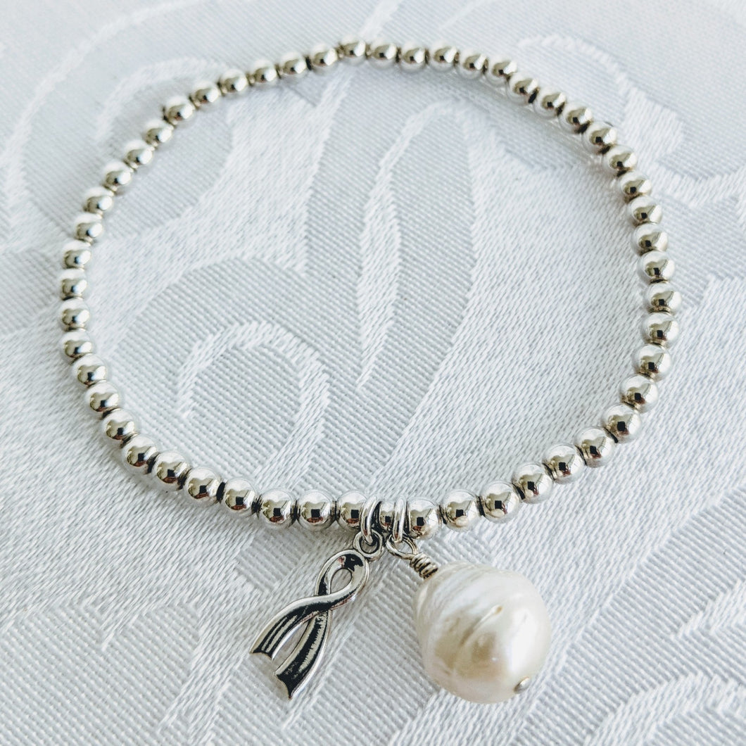 Silver balls with silver awareness ribbon and pearl charm
