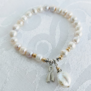 Pearl with silver awareness charm and Keshi pearl charm
