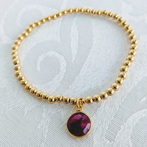 Gold beads with ruby