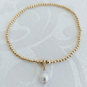 Tiny sterling gold balls with pearl charm