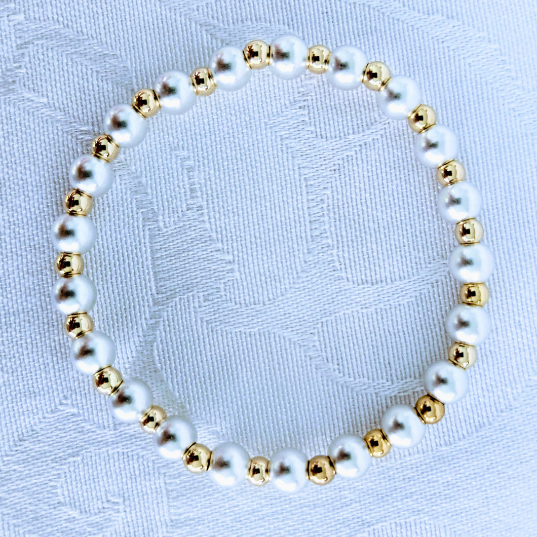 Alternating matte Sterling silver beads and bright 14k gold fill beads