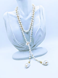 "Pearl Lariat - 40"". Choose from white, light pink, light gray and taupe"