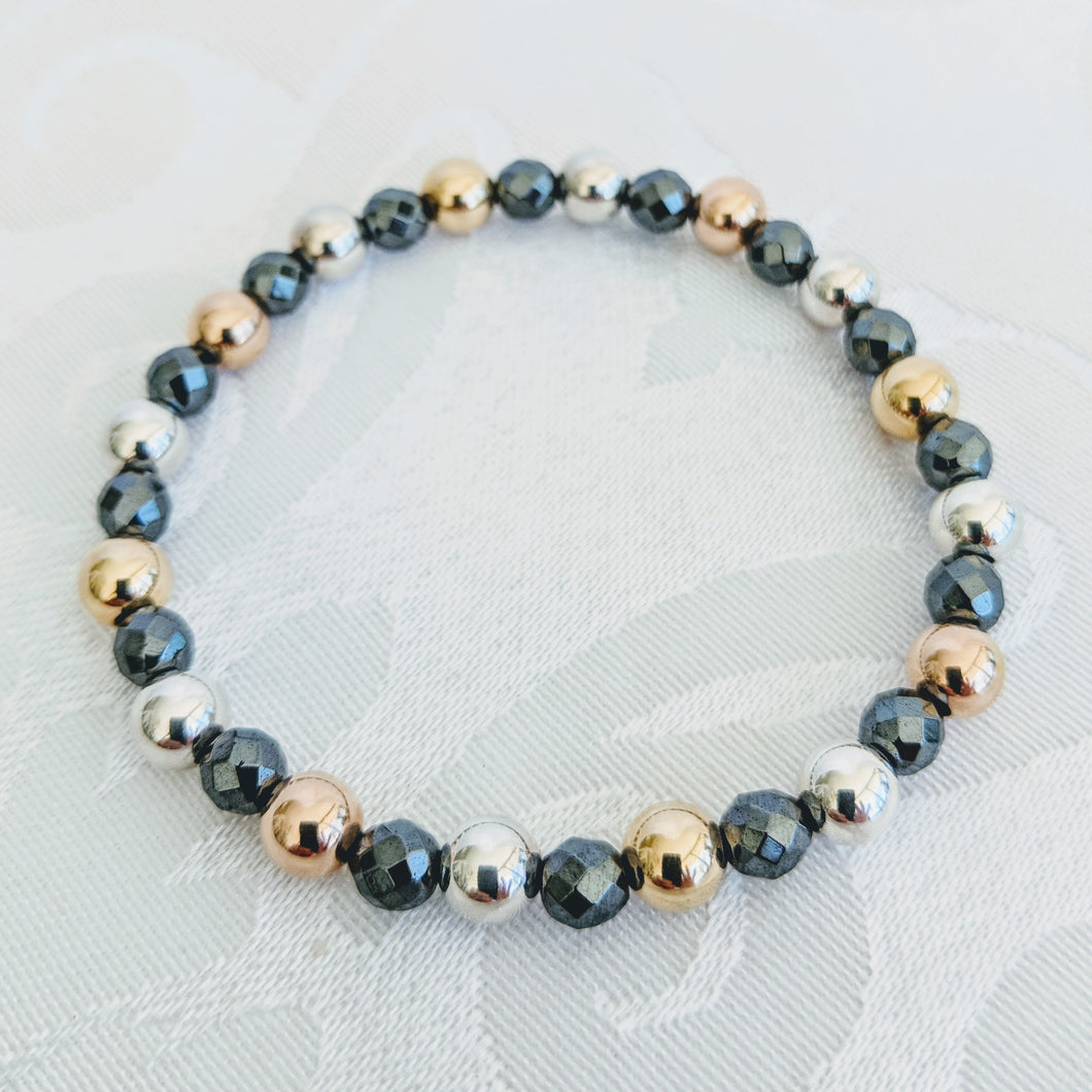 Faceted Hematite with gold, rose gold & silver