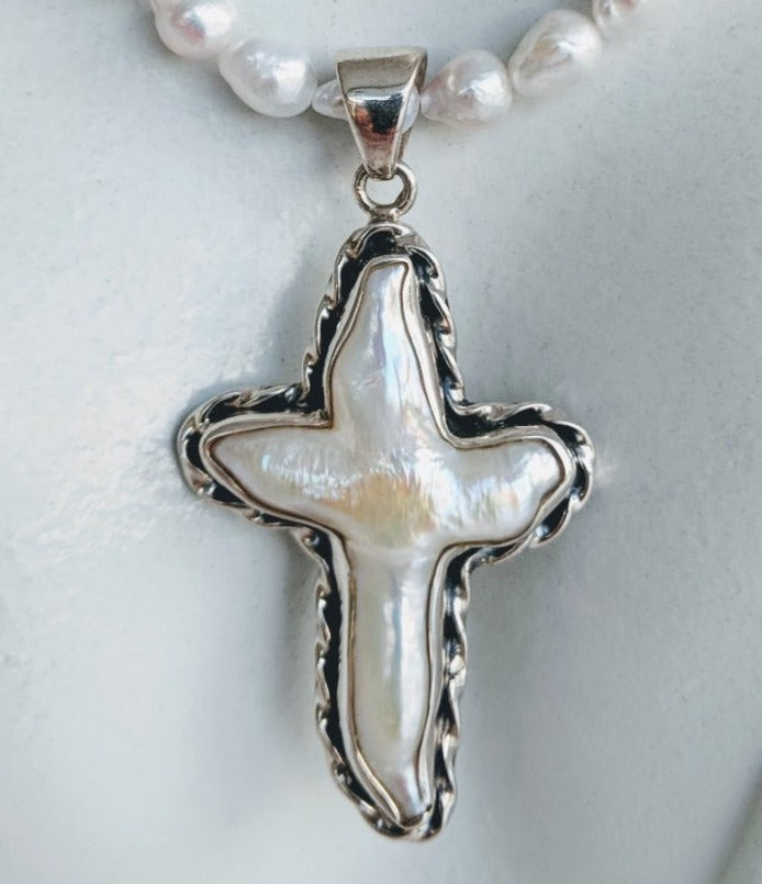 Cultured natural pearl cross set in Sterling silver
