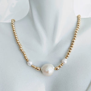 Gold ball and pearl necklace