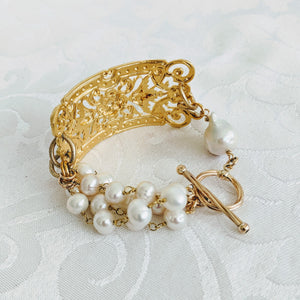 Ornate plate and pearl bracelet