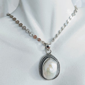 Sterling silver rope pendant with large pearl
