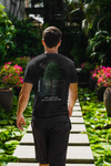 Man walking through garden wearing black tree tshirt