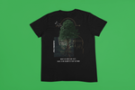 black flat tshirt on a green surface
