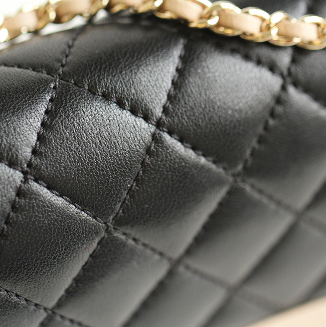 bag-religion Mademoiselle Vintage Flap Bag in black and beige shiny sheepskin leather