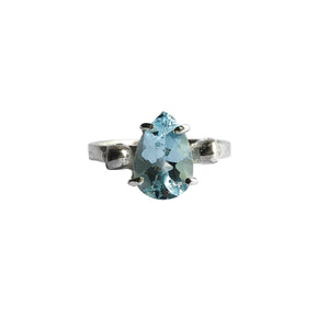 Twin Skull Solitaire With Blue Topaz