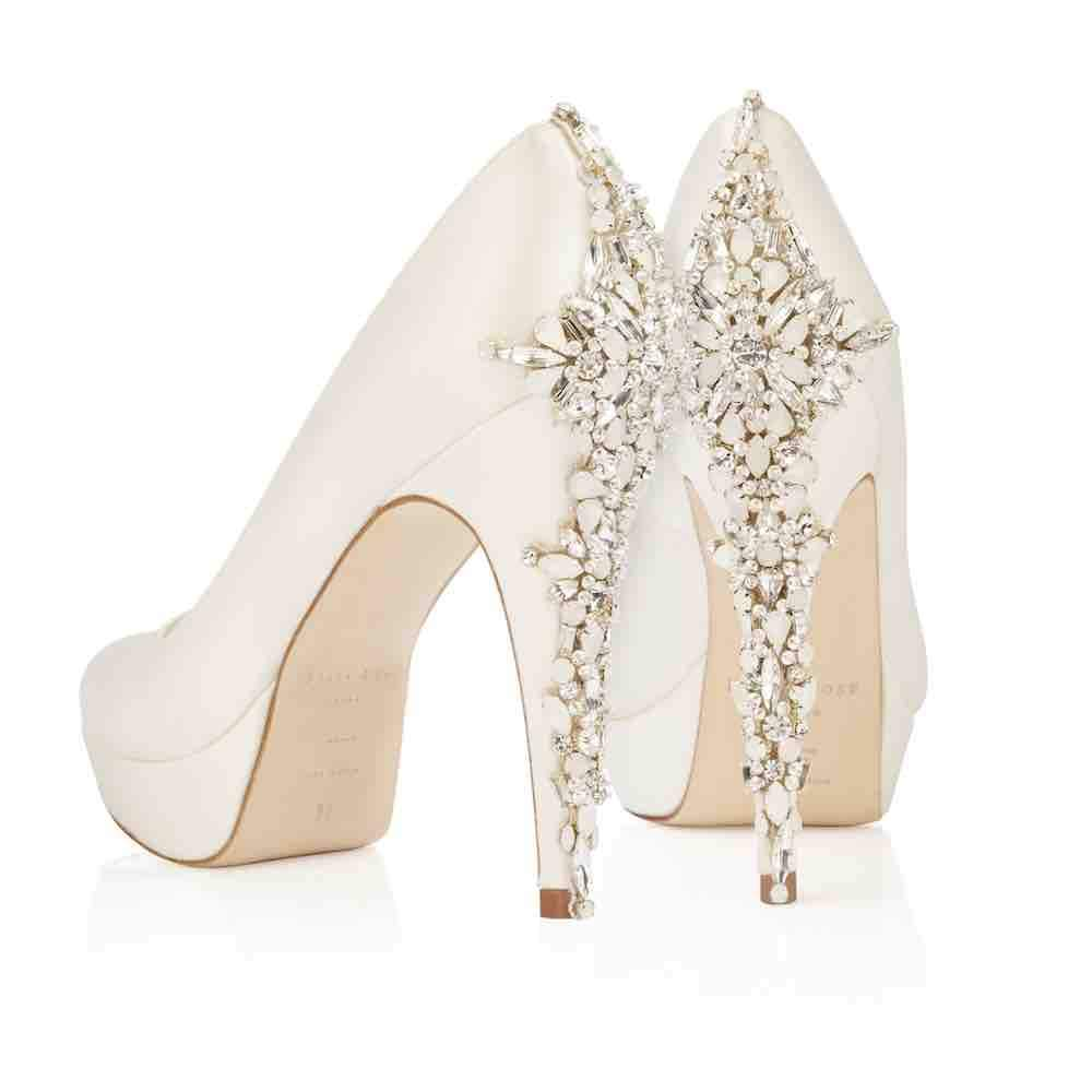 Toes in Bows exclusively bring you Catherine by Freya Rose.  Ivory Satin Platform Shoe  finished with Hand Embellished Crystals.  This silk platform shoe is a classic silhouette and features an almond shape toe. the rich silk sheen is so lustrous and could only be made by award winning   Freya Rose .