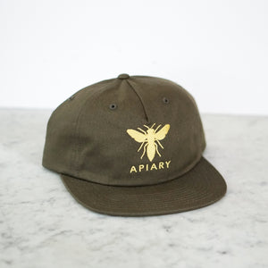 "Army green hat shows apiary beee logo and word ""APIARY"""