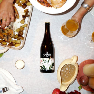 "Picture of California heirloom bottle in a ""Thanksgiving Dinner"" scene."