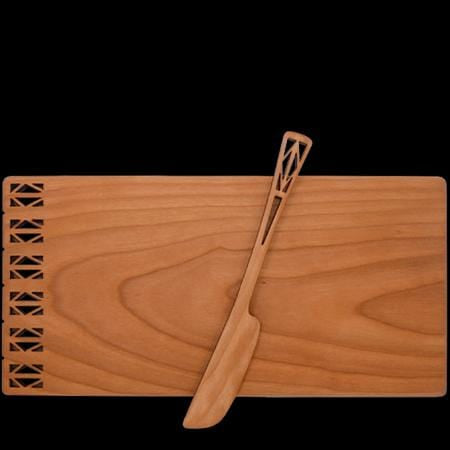 Cheese board and spreader with architectural design, made of cherry wood.