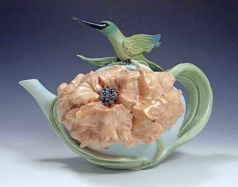 Large peony covers the teapot with a hummingbird perched on top, soft greens, blues and a peachy pink peony.
