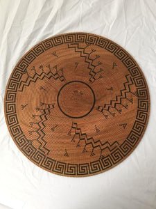 large turned wood platter, painstakingly scored and hand painted with authentic Hopi-inspired design inscribed on both front and back. It looks like an antique basket, but it is not. Bottom view.