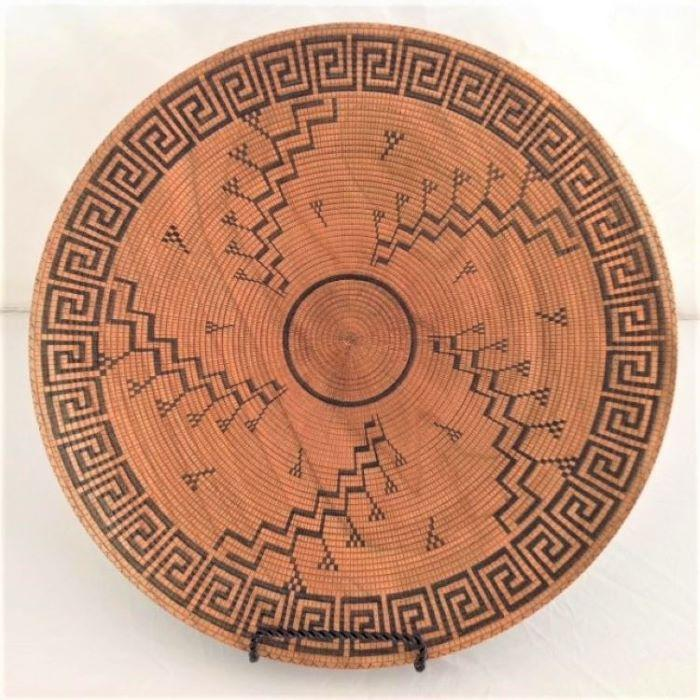 large turned wood platter, painstakingly scored and hand painted with authentic Hopi-inspired design inscribed on both front and back. It looks like an antique basket, but it is not.
