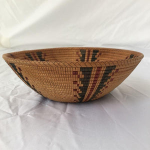 Side view of turned and scored wood bowl, hand painted inside and out with an authentic black and red Yokut design, (from the Four Corners area) This looks like a woven Native American basket, but is not.