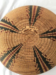 Signature on bottom of turned and scored wood bowl, hand painted inside and out with an authentic black and red Yokut design, (from the Four Corners area) This looks like a woven Native American basket, but is not.