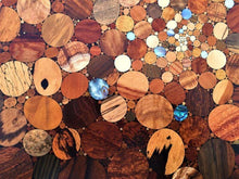 Load image into Gallery viewer, Over 100 kinds of wood and shell in a kaleidoscope effect of the big bang, detail of wood inlaid wall art piece.