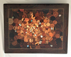 Over 100 kinds of wood and shell in a kaleidoscope effect of the big bang, framed in very deep dark wood with pale inlaid line. Wood inlay wall art .