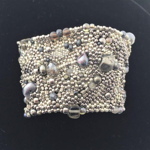 textural beaded cuff bracelet in silver and irridecent blues front view