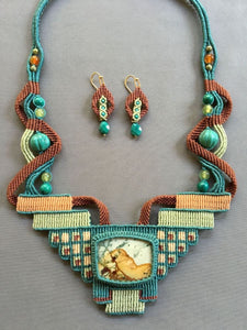 tapestry necklace with picture jasper centerpiece  stone, in leaf green, seafoam and rust tapestry, with turquoise, carnelian and gasparite beads.