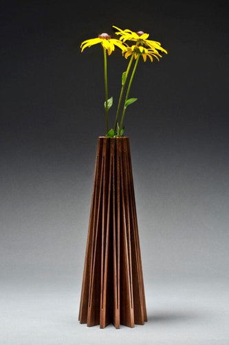 Walnut vase cut from one piece of wood and opened up to create a beautiful form, with glass vial inside for water and flowers
