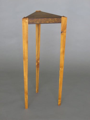 Laurel burl triangle table with triangular teak legs and wenge inlay details in the top and on legs
