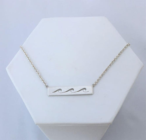 waves necklace. Three cut out waves roll across a sterling silver bar with silver chain