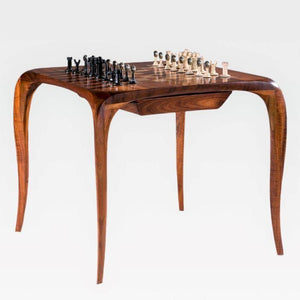 wood chess table and metal chess pieces