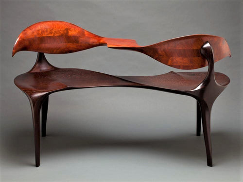 Tete-a-tete, or face-to-face, a bench for intimate conversations. Carved African mahogany and wenge.