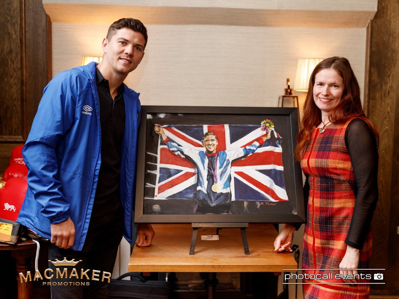 Luke Campbell MBE and Michelle Turner with the original painting 'Luke Campbell - Olympic Gold' by Michelle Turner at Michelle's  'Art of Boxing Exhibition' February 2020. With thanks to MacMaker Promotions and Photocall Events
