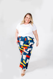 Multi Color Yellow, Blue, Red, Black Geometric Pattern Pants with elastic waistband, drawstrings, and pockets. Plus Size.