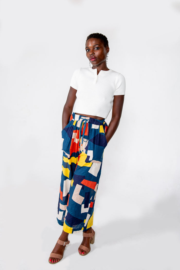 Multi Color Yellow, Blue, Red, Black Geometric Pattern Pants with elastic waistband, drawstrings, and pockets