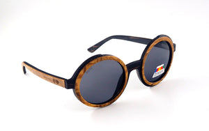 Shaydz Sunglasses Bliscoe is a highly unique and individual design. This striking round wooden frames is double layered with Burl wood and Ebony. Thus making this frame very sought after.