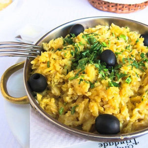 Learn the steps to making Portugal's national dish - Bacalhau à Brás.