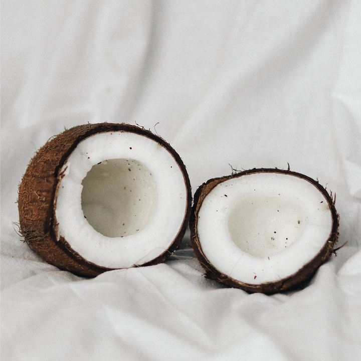 Image of a coconut showing the coconut meat, a source of healthy fats